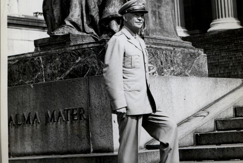 Columbia President Dwight Eisenhower standing next to Alma Mater.