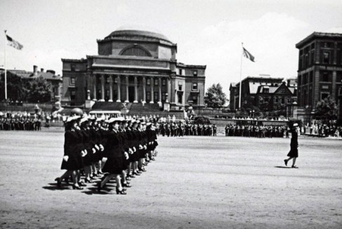 Navy WAVES (Women Aceepted for Voluntary Emergency Service), marching in review on South Field. Low library and Kent Hall are in the background.
