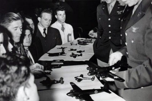 Army Air Corps officers with model airplanes at a recruiting rally at Columbia College, May 1942.