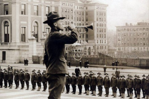 "Bugler on the steps of Low Library. The back of the photograph reads, ""United States School of Military Cinematography which trains war photographers for land"