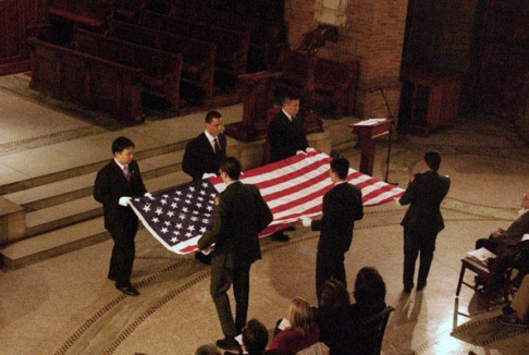 Columbia University chaplain's prayer for troops and veterans, featuring the military-style folding and presentation of the flag, which had been given to the family of Chaplain Jewelnel Davis at the funeral of her father, a Korean War veteran.The military veterans participating in the ceremony were Julia Oh, Michael Nicholas, Eric Chen, Peter Kim—all of whom served in Korea—and Matt Sanchez, a corporal in the U.S. Marines. Oh is a graduate student in the School of Engineering and Applied Sciences; the other